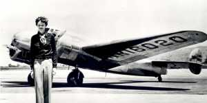 Amelia Earhart standing in front of the Lockheed Electra in which she disappeared in July 1937. Born in Atchison, Kansas in 1897, Amelia Earhart did not begin flying until after her move to California in 1920. After taking lessons from aviation pioneer Ne